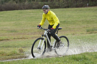 Germany, Bavaria, Oberland, Mature man cycling - DSF000567