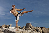 Germany, Bavaria, Young man doing martial arts training - MAEF004672