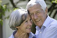 Germany, Bavaria, Senior couple smiling, close up - TCF002580