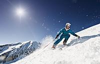 Austria, Salzburg, Young man skiing on mountain - HHF004188