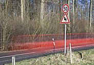 Germany, Red car passing through country road - FLF000069