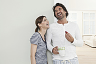 Germany, Berlin, Mature couple smiling, man holding strawberry - FMKYF000131