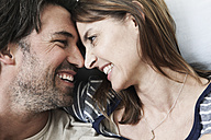 Germany, Berlin, Mature couple smiling - FMKYF000140