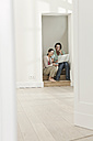 Germany, Berlin, Mature couple moving to new house - FMKYF000143