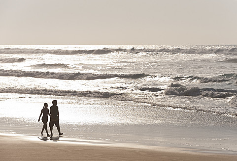 Portugal, Couple walking on beach - MIRF000464