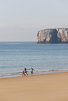 Portugal, Family running on beach - MIRF000491