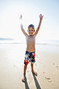 Portugal, Boy standing on beach, smiling - MIRF000497