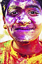 India, Ahmedabad, Young man celebrates Holi festival - MBE000354