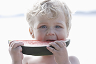 Germany, Bavaria, Boy eating watermelon, close up - TCF002737