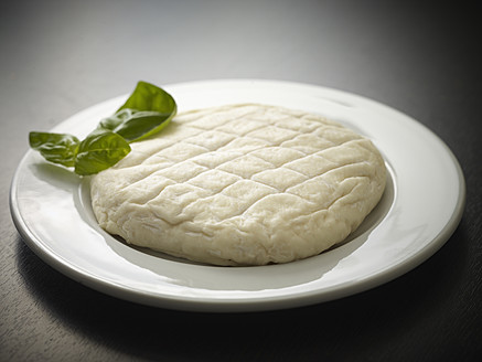 Germany, Cologne, French soft cheese with basil, close up - RHYF000200