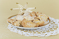 Plate of Christmas biscuits and straw star decoration - GWF001839