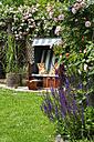 Germany, North Rhine Westphalia, Drensteinfurt, Beach chair in rose garden - VDSF000005