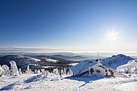 Germany, Bavaria, View of snow covered mountain hut at Bavarian Forest - FOF003906