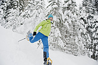Austria, Salzburg County, Young woman snowshoeing - HHF004273