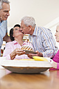Germany, Leipzig, Senior men and women celebrating birthday, man kissing to woman - WESTF018805