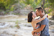 USA, Texas, Leakey, Young couple kissing, close up - ABA000050