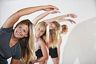 Women and teenage girl exercising, smiling, portrait - ABA000082