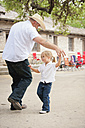 USA, Texas, Father dancing with daughter - ABA000101