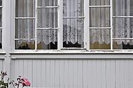 Germany, Ruegen, Cape Arkona, Old window with curtain - AXF000116