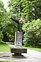 Germany, Bavaria, Young man doing martial arts in park - MAEF004776