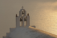 Greece, Bell Tower of whitewashed church and sea in background Imerovigli  at Santorini - RUEF000941