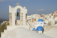 Greece, View of Oia village with bell tower at Santorini - RUEF000947