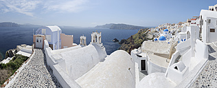Greece, View of Oia village with cobbled path and bell tower at Santorini - RUEF000950