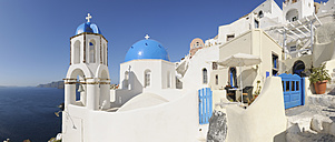 Greece, View of classical whitewashed church and bell tower at Oia - RUEF000965