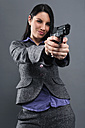 Young woman wearing holding gun, portrait, close up - RDF001023