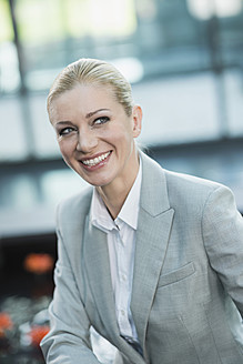 Germany, Stuttgart, Businesswoman smiling - MFPF000218