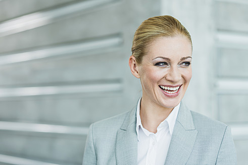 Germany, Stuttgart, Businesswoman smiling - MFPF000221