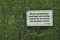 Germany, Bavaria, Close up of German sign at wire mesh fence - AX000202