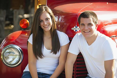 USA, Texas, Teenage boy and girl smiling, portrait - ABAF000145