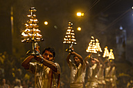 India, Uttar Pradesh, Priests celebrating River Ganges Aarti - FO004176