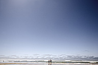 France, Two boys walking on beach with body surfboards - MSF002720