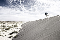 France, Boy jumping on sand dune - MSF002726