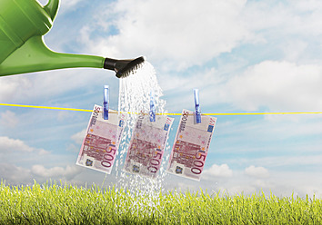 Germany, Watering five hundred euro note on clothing line - WBF001281
