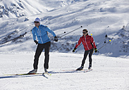 Germany, Man and woman skiing in snow - WBF001478