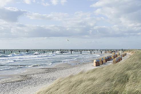 Germany, Mecklenburg Western Pomerania, Seagull flying at Baltc Sea - MJF000110