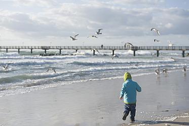 Germany,  Mecklenburg Western Pomerania, Boy running on Baltic Sea - MJF000113