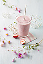 Glass of strawberry smoothie with cornflower blossom - ECF000042