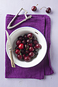 Bowl of cherries with pit remover and knife - ECF000061
