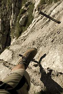 Germany, Bavaria, Man climbing mountain - KAF000018
