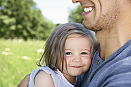 Gemany, Cologne, Father and daughter smiling, close up - PDYF000019