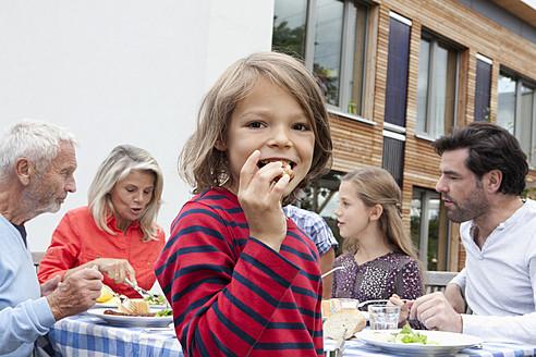 Germany, Bavaria, Nuremberg, Family barbecue in garden - RBYF000123