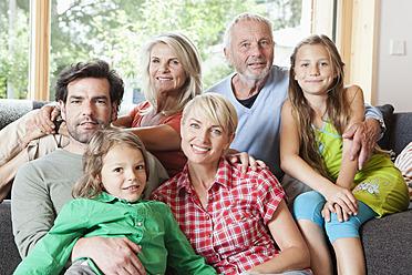 Germany, Bavaria, Numerberg, Portrait of family in living room - RBYF000141