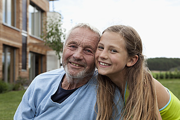 Germany, Bavaria, Nuremberg, Grandfather and granddaughter smiling, portrait - RBYF000180