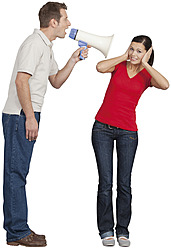 Mid adult man with megaphone shouting on young woman - WBF001518