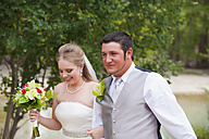 USA, Texas, Bride and groom smiling, close up - ABAF000264