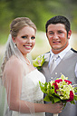 USA, Texas, Bride and groom smiling, portrait - ABAF000260